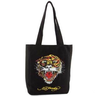 "Ed Hardy Ness Tiger Tote- Black - The Ed Hardy Ness Tiger Tote- Black is perfect for Back to School or that  trendy kid that wants to look Hot and Fashionable . Front features the ed hardy ""Tiger"" and has Rhinestone detail. Includes An Internal Zip pocket for plenty of storage and Signature Ed Hardy Logo lining."